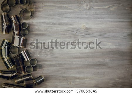 Old film  on Wooden background  - stock photo