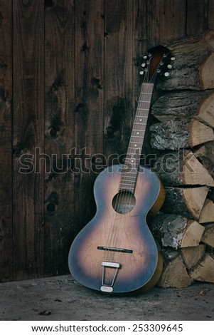 old guitar with wood