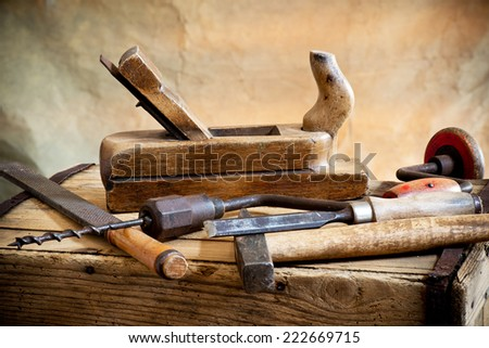 old hammer and carpentry tools - stock photo