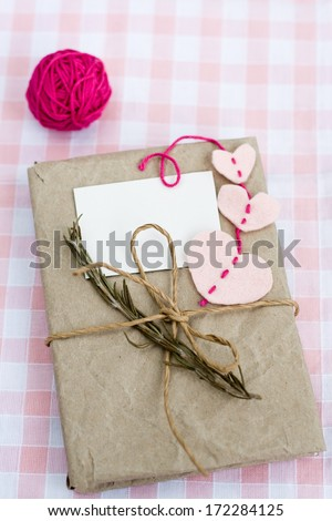 Old notebook with a dry branch of rosemary for love notes - stock photo