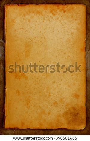 old paper on a old bronze background - stock photo