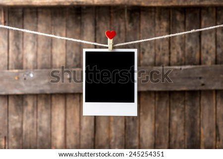 Old picture frame hanging on the clothesline,Selective focus,Clipping path for insert Photo - stock photo
