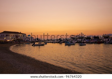 """Old Port"" in the Chora of Mykonos Island at sunset. Greece. - stock photo"