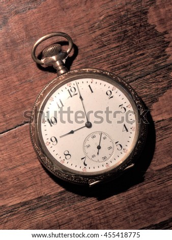 """Old Time"" - Antique Gold Pocket Watch isolated Close Up image lying on Oak Table surface."