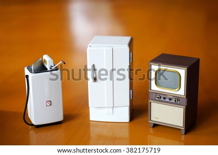 Old TV washing machine refrigerator Consumer Appliance Electronics model - stock photo