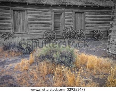 old wild West, old broken wood wheels - stock photo