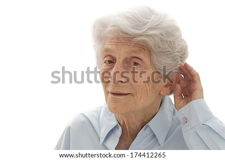 Old woman having difficulty in hearing isolated in a white background  - stock photo