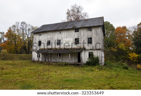 old wooden abandoned mill white color. Belarus - stock photo