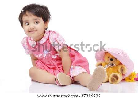 2-3 old year baby girl securing teddy bear - stock photo