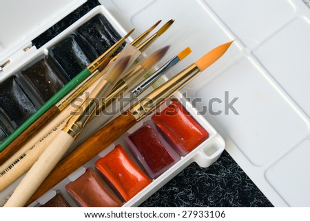 Ð¡olours and brushes - stock photo