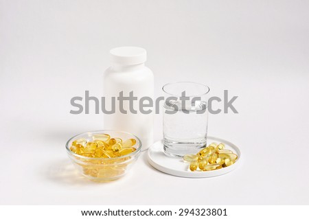 Omega 3 capsule with fish oil, soft gels, healthy nutritional supplement, natural fats, selective focus, white background - stock photo