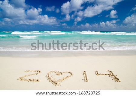 2014 on beach - concept holiday background