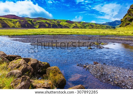 On bottom of canyon many streams flow. Canyon Pakgil in Iceland.  Picturesque basalt hills overgrown green grass and moss - stock photo