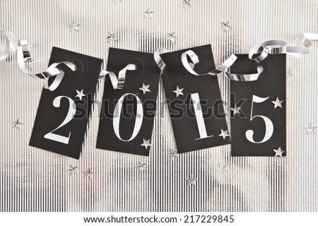 2015 on shiny background with star confetti - stock photo