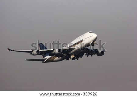 747 on takeoff - stock photo