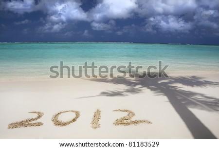 2012 on the beach of tropical island - stock photo