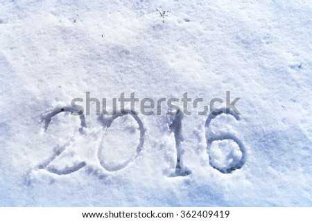 2016 on the snow for the new year and Christmas. Cool Blue filter applied. - stock photo