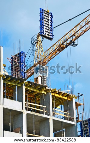 ?oncrete formwork under crane on construction site - stock photo