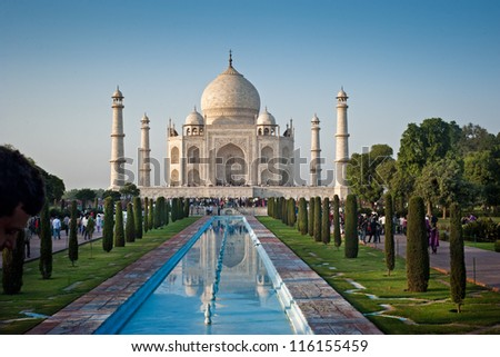 One of the seven wonders of the world - Taj Mahal mausoleum in evening light. Arga, India. - stock photo