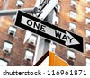 """one way"" sign on pole in street in u.s.a. - stock photo"