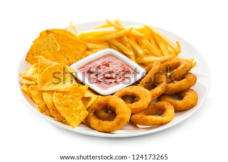 onion rings, fries and nachos on a white background - stock photo