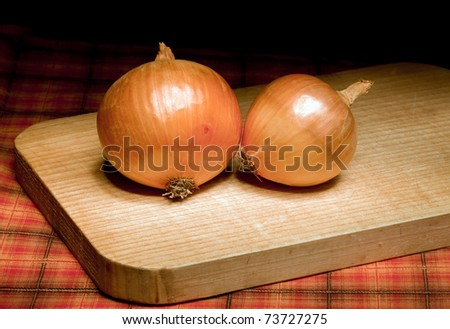 onions on a wooden board - stock photo