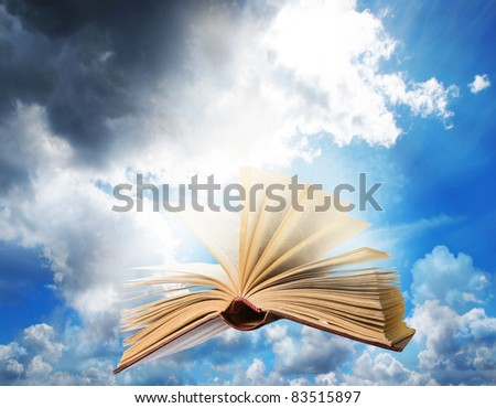 open book and sky - stock photo