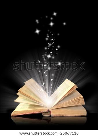 Open book magic on black - stock photo