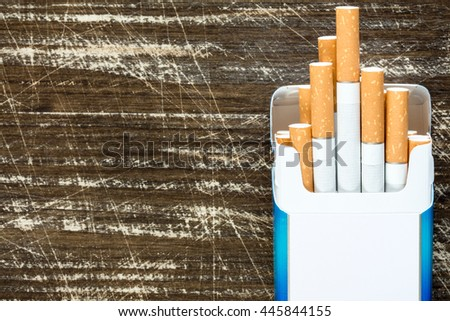 Open pack of cigarettes with cigarettes sticking out. - stock photo