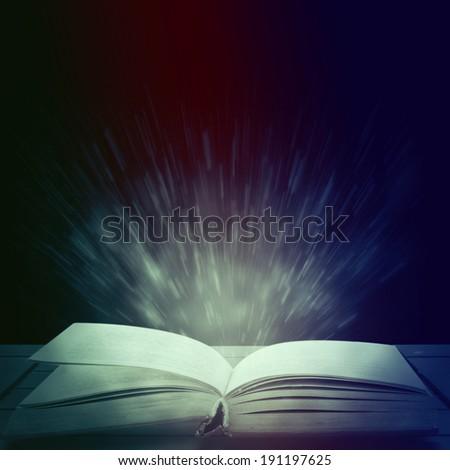 Opened magic book - stock photo