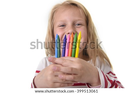 6 or 7 years old beautiful little girl holding multicolor crayons set in art school children education concept isolated on white background - stock photo