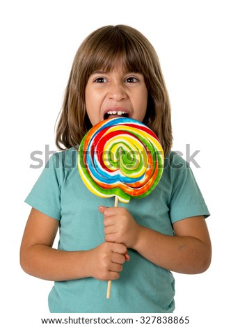 4 or 5 years old child girl eating big multicolor spiral lollipop candy isolated on white background in children love sweet and sugar concept and dental health and care concept - stock photo