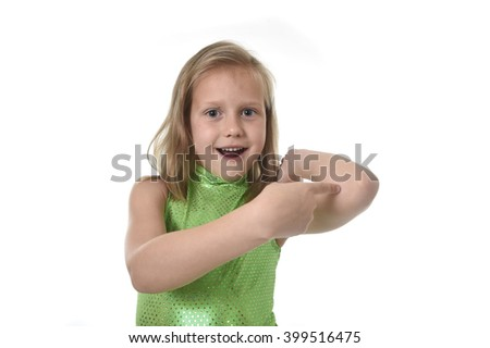 6 or 7 years old little girl with blond hair and blue eyes smiling happy posing isolated on white background pointing elbow in language lesson for child education and body parts school chart set - stock photo