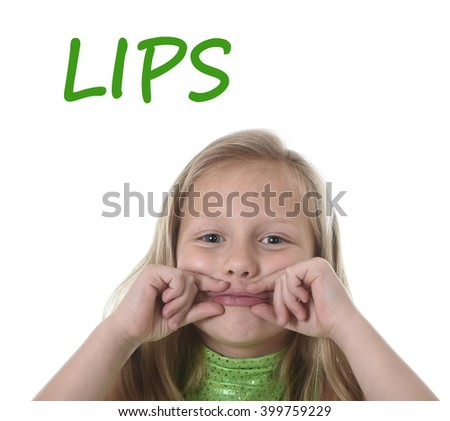 6 or 7 years old little girl with blond hair and blue eyes smiling happy posing isolated on white background showing her lips in learning English language school education body parts card set - stock photo