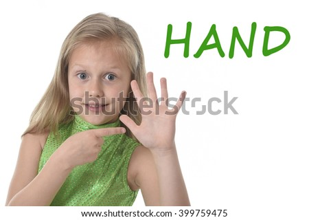 6 or 7 years old little girl with blond hair and blue eyes smiling happy posing isolated on white background pointing hand in learning English language school education body parts card set - stock photo