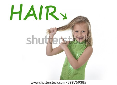 6 or 7 years old little girl with blue eyes smiling happy posing isolated on white background pulling pointing her blond hair in learning English language school education body parts card set - stock photo