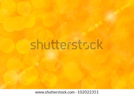 Orange and yellow bokeh abstract light background - stock photo