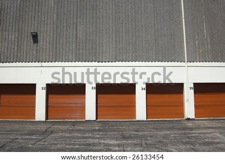 orange public storage gates /  facility for  rent - stock photo