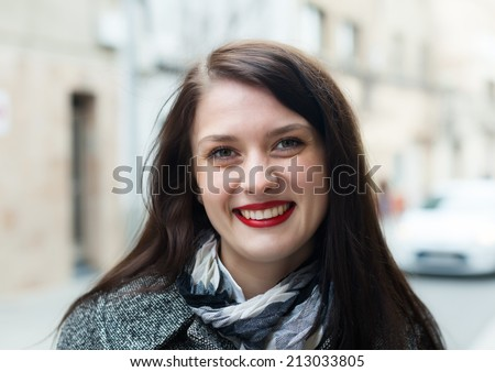 ordinary woman in autumn  street - stock photo