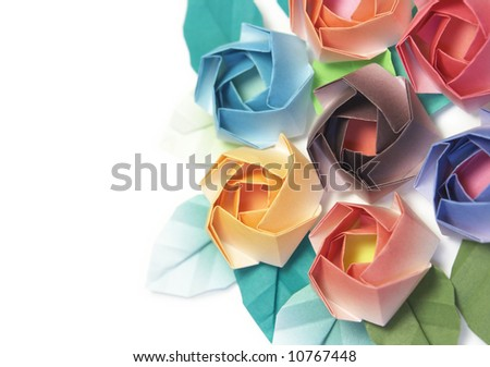 7 origami roses decoration on a white background - stock photo