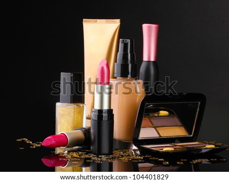 ?osmetics isolated on black - stock photo