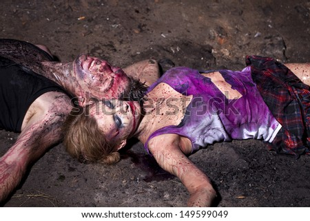 ???ouple of bloody victims - stock photo