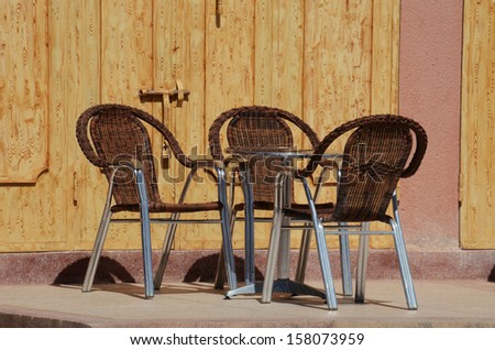 3 outdoor rattan chairs at cafe and restaurant for enjoy drink and eating - stock photo