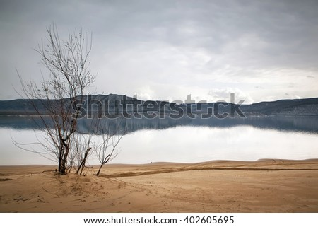 Overcast landscape. River and mountans. - stock photo