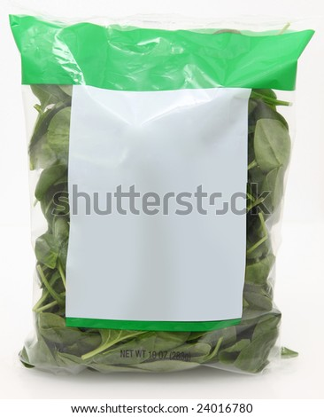 10 oz bag of raw spinach with blank label for text. - stock photo