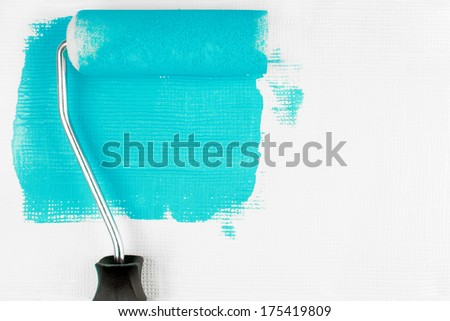 paint wall with paint roller - stock photo