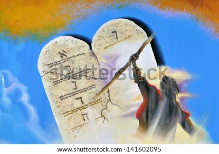 Painted theatre backdrop featuring Moses and the Ten Commandments - stock photo