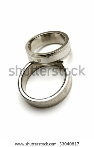 pair of wedding rings isolated on white - stock photo