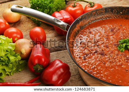pan of hot chili con carne, ready to serve. - stock photo