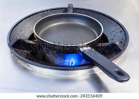 pan on a kitchen stove. - stock photo